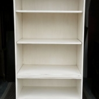 Large Bookshelf in distressed Off White with Tobacco Glaze. Middle shelf adjustable.