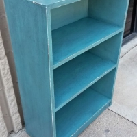 Small bookshelf in distressed Sea Blue with Black Glaze.