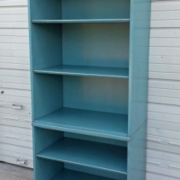 Cabinet repurposed into a bookshelf. In distressed Sea Blue with Black Glaze.