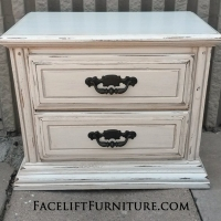Nightstand in distressed Antiqued White and Tobacco Glaze, with hardware painted dark bronze. From Facelift Furniture's Antique White Furniture collection.