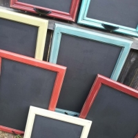 Cabinet doors repurposed in chalkboards. From Facelift Furniture.