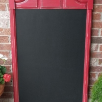 Large chalkboard repurposed from vintage mirror frame. In distressed Barn Red and Black Glaze. From Facelift Furniture's Chalkboards collection.