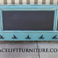 Footboard repurposed into coat rack and chalk board. In distressed Sea Blue with Black Glaze. From Facelift Furniture's Repurposed Wall Pieces Collection.