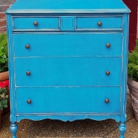 "For Sale $245 - Antique chest of drawers in distressed peacock blue with black glaze. Four drawers with new knobs. 41"" tall, 34"" wide, 19"" deep. Call Jeff at 979-575-7627 to purchase."