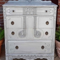 Art deco antique chest of drawers in distressed Aspen Gray with Black Glaze. Four drawers with original pulls. From Facelift Furniture's Chests of Drawers collection.