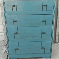 Vintage Chest of Drawers in distressed Sea Blue with Black Glaze. New pulls. From Facelift Furniture's Chests of Drawers collection.