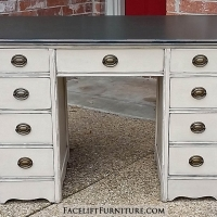 Desk in distressed Dark Brown and Oatmeal with Black Glaze. Seven drawers with original vintage pulls. From Facelift Furniture's Desks & Vanities collection.