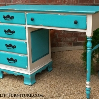Desk in distressed Turquoise and Off White, with Black Glaze. Pulls painted black.