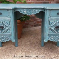 Ornate vanity desk in Sea Blue with Black Glaze. Heavy distressing reveals white primer and original wood tones. Distressed Off White desk with Tobacco Glaze. Three drawers, with original knobs and pulls painted dark bronze. From Facelift Furniture's Desk & Vanities collection.