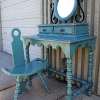 Vintage Vanity with Chair & Mirror, in Sea Blue with Black glaze accenting many detailed areas. Original color of piece was a red-orange, which peaks through in distressing. From Facelift Furniture's Desks & Vanities collection.
