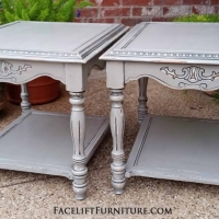 Ornate end tables in Aspen Gray with Black Glaze. Distressing reveals white primer and original wood tones. From Facelift Furniture's End Tables collection.