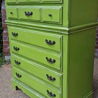 Vintage 1962 maple chest of drawers in Lime Green with Black Glaze accenting molding. Distressing reveals white primer and original wood tones. Four drawers with original pulls.