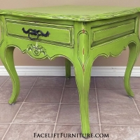 Ornate Curvy End Table in Lime Green with Black Glaze, with distressing revealing white primer. Original vintage pull. From Facelift Furniture's Lime Green Furniture collection.