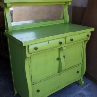 Antique Buffet in distressed Lime Green with Black Glaze. Repurposed as a baby changing table. From Facelift Furniture's Lime Green Furniture collection.