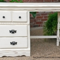Distressed Off White desk with Tobacco Glaze. Three drawers, with original knobs and pulls painted dark bronze. From Facelift Furniture's Desk & Vanities collection.