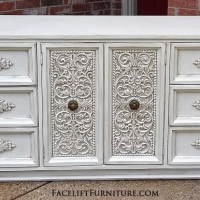 "Large dresser in distressed off white with espresso glaze. All wood drawers with original pulls. Three drawers behind ornate double doors. 75"" long, 20"" deep, 31"" tall. From Facelift Furniture's Dressers collection."