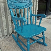 Child's rocker custom painted Peacock Blue with Black Glaze. Distressed down to white primer and original wood tones. From Facelift Furniture's DIY Inspiration album.