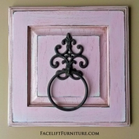 Towel Holder in distressed Pink with Black Glaze. Repurposed from small cabinet door.