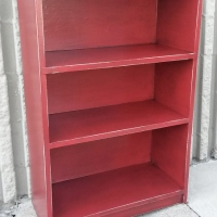 Small bookshelf in distressed Barn Red with Black Glaze. From Facelift Furniture's Red Refinished Furniture collection.