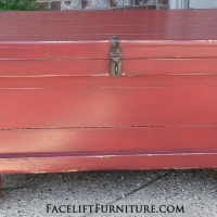 Old trunk in distressed Barn Red with Black Glaze. From Facelift Furniture's Red Refinished Furniture collection.