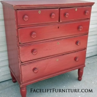 Antique chest of drawers with original wood pulls in distressed Barn Red with Black Glaze. From Facelift Furniture's Red Refinished Furniture collection.