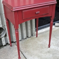 Antique Sewing Table in distressed Barn Red with Black Glaze. From Facelift Furniture's Red Refinished Furniture collection.