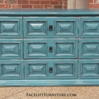 Dresser in Sea Blue with Black Glaze. Nine drawers, with distressing revealing white primer and original wood tones. New pulls. From Facelift Furniture's Sea Blue Furniture collection.