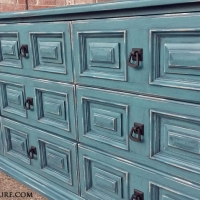 Dresser in Sea Blue with Black Glaze. Nine drawers, with distressing revealing white primer and original wood tones. New pulls.