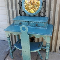 Vintage Vanity with Chair & Mirror, in Sea Blue with Black glaze accenting many detailed areas. Original color of piece was a red-orange, which peaks through in distressing. From Facelift Furniture's Sea Blue Furniture collection.
