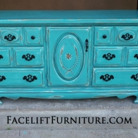 Large Dresser in Turquoise and Black Glaze. Heavily distressed, revealing white primer. Original hardware painted black. From Facelift Furniture's Turquoise Refinished Furniture collection.