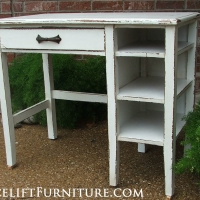 Chippy distressed Desk in Antiqued White.  Original drawer pull. From Facelift Furniture's DIY Inspiration album.