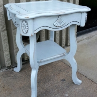 Ornate End Table custom painted distressed Light Blue (provided by customer), with Black Glaze accenting detailed areas. From Facelift Furniture's DIY Inspiration album.