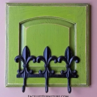 Coat Rack in distressed Lime Green with Black Glaze. Repurposed from small cabinet door.