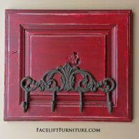 """Coat Rack in distressed Chili Pepper Red with Black Glaze. 14"""" tall, 16"""" wide."""