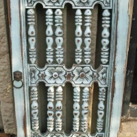 Ornate door hutch in distressed Robin's Egg Blue with Black Glaze. From Facelift Furniture's Repurposed Wall Pieces collection.