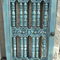 Ornate door hutch in distressed Sue Blue with Black Glaze. From Facelift Furniture's Repurposed Wall Pieces collection.