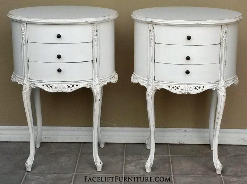 Oval French Nightstands in distressed Antiqued White with light Tobacco Glaze. From Facelift Furniture's Antique White Furniture collection.