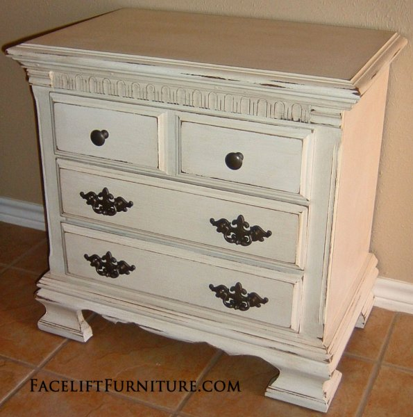 Distressed Antiqued White Nightstand with Tea Stained Glaze. From Facelift Furniture's Antique White Furniture collection.