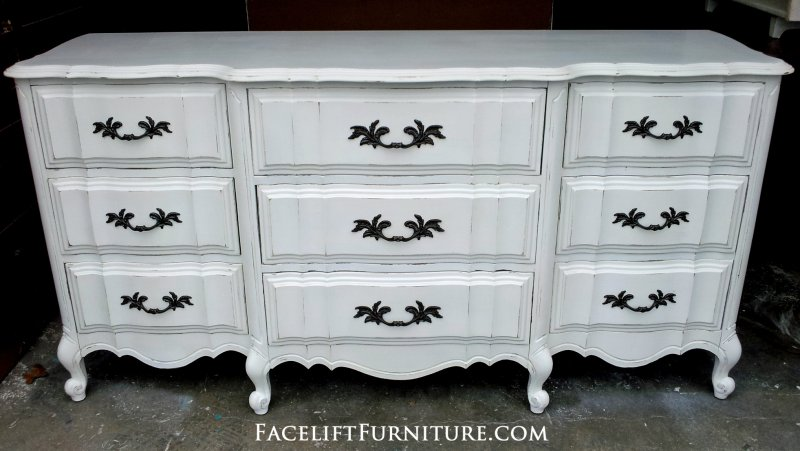 Antiqued White French Provincial Dresser. Original pulls. From Facelift Furniture's Antique White Furniture collection.