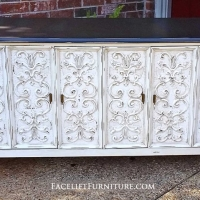 Ornate Buffet in distressed Dark Brown and Antiqued White with Tobacco Glaze. Folding doors, with three drawers behind right side, and double shelf storage on left. From Facelift Furniture's Hutches, Cabinets & Buffets collection.