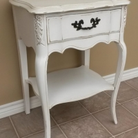 Curvy French Nightstand in distressed Antiqued White with light Tobacco Glaze. From Facelift Furniture's Antique White Furniture collection.