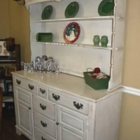 Melody chose to have her old hutch upstyled in antiqued white.
