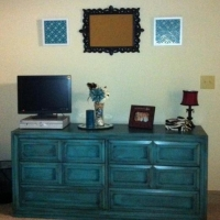 Cheyenne custom ordered this dresser from our inventory. Painted turquoise, distressed and with heavy black glaze, it is now in her bedroom.