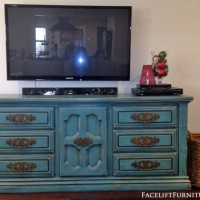 Kassie's distressed  chunky Sea Blue Dresser with Black Glaze, re-purposed as an entertainment console.