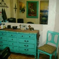 Brandi's pieces in her room at the French Door Salon. The dresser, frame and chair are painted turquoise, with black glaze accenting detailed areas.