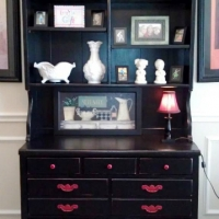 Johnann's hutch painted distressed Black, with original hardware painted red.