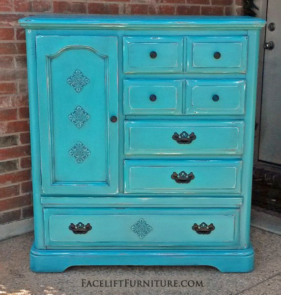 Large Chest of Drawers in Turquoise with Black Glaze. Distressing reveals reveals white primer and original wood tones. Vintage pulls painted black. Three shelf storage area behind door.