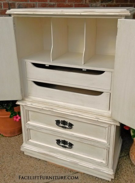 Clothing Armoire in distressed Off White with Tobacco Glaze. Two drawers and three storage compartments behind doors. From Facelift Furniture's Chests of Drawers collection.