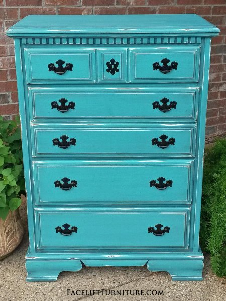 Distressed Turquoise Chest of Drawers with Black Glaze, with distressing revealing white primer and original wood tones. Original pulls painted black. deep.