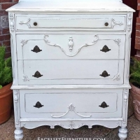 "Large ornate antique chest of drawers in lightly distressed Antiqued White with Espresso Glaze. Four drawers with original pulls. 48.5"" tall, 38"" wide, 20"" deep."